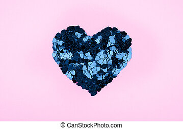 Heart of small blue hearts on a pink background.