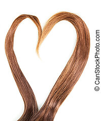 Heart of smooth hair strands isolated on a white background