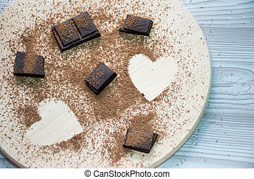 heart of sugar on wooden background