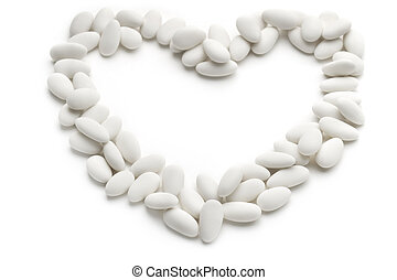 heart of sugared almonds on white background
