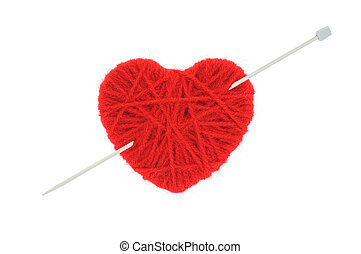 Heart of yarn - woollen heart made on yarn isolated on white...
