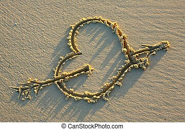 Heart on a sandy beach