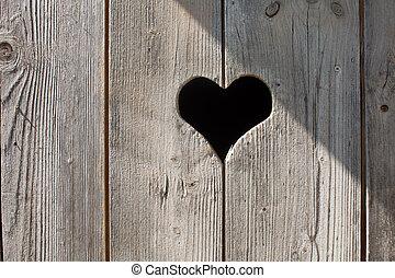 heart on a wooden door