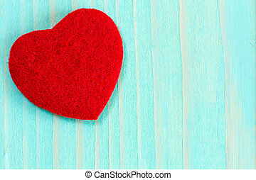 Heart on blue wooden background