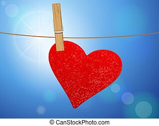 Heart hanging on clothesline at sky.