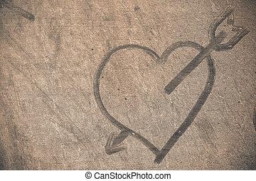 Heart on dusty floor.