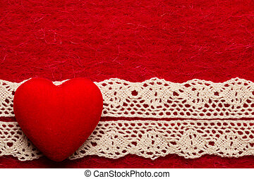 heart on red cloth background