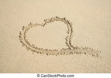 heart on sand - love message sent through a sand writing on...