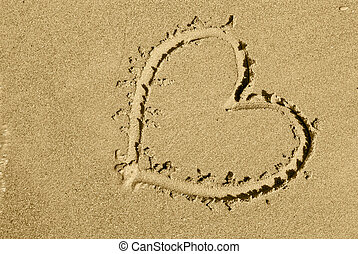 heart on sand on sea beach