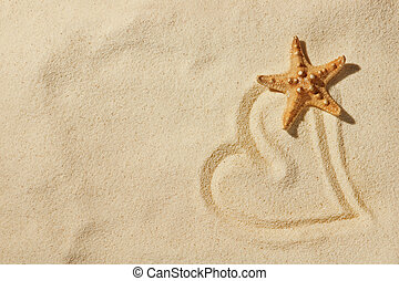 heart on sand on sea beach