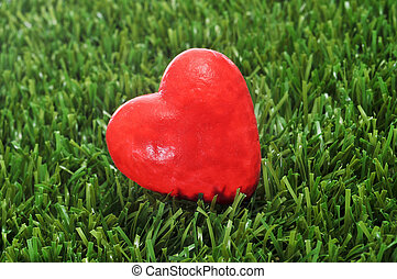 heart on the grass - closeup of a red heart on the grass