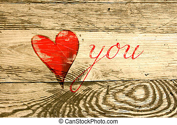 Heart on weathered wooden background
