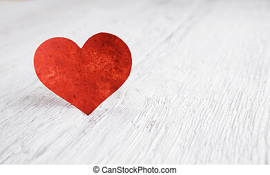 Heart on white wood background