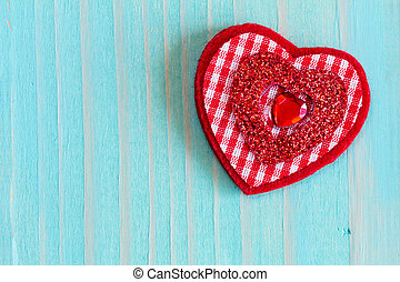 Heart on wooden background with copy-space