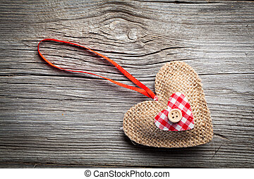 Heart over wooden background