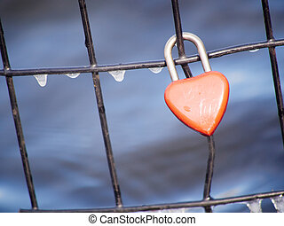Heart padlock on fence