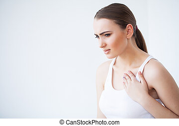 Heart pain. Beautiful Woman Suffering From Pain In Chest. Health Issues