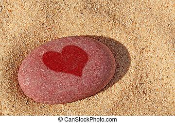 Heart pebble on the beach.