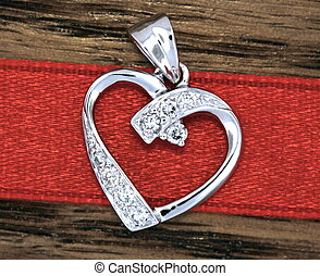 Heart Pendant - closeup of a diamond heart pendant with red...