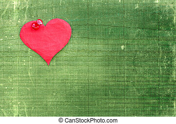 Heart pinned to the green wall