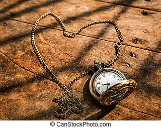 heart pocket watch on a wood background with natural light.
