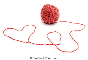 Heart shape and wool ball on white background - Closeup of...