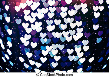 Heart shape blurred bokeh background with sparkles