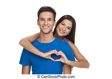 Heart shape. Cheerful young woman and man holding their...