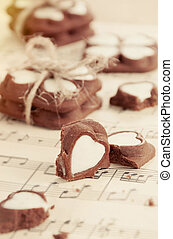 heart shape chocolate cookies on old music notes - heart...