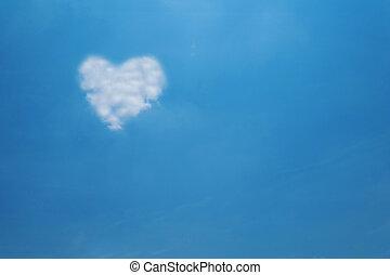 Heart shape cloud on blue sky