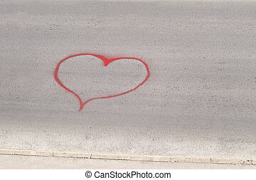Heart shape drawn on a street asphalt