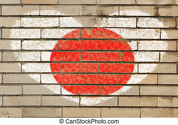 heart shaped flag in colors of Japan on brick wall