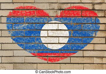 heart shape flag of laos on brick wall