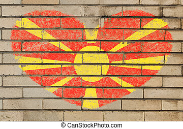 heart shape flag of macedonia on brick wall