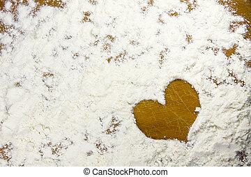 heart shape in a flour