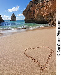 Heart shape in the sand on Valentine's Day.