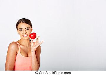 Heart shape in woman's hands.