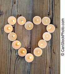 Heart shape made from burning candles - Heart shape made...