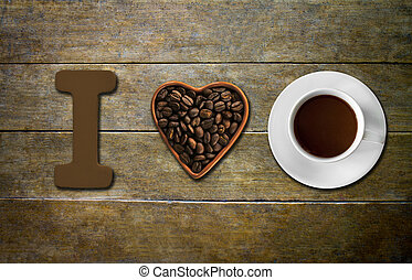 I love coffee - Heart shape made from coffee beans with a ...