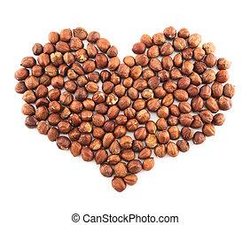 Heart shape made of hazelnuts isolated