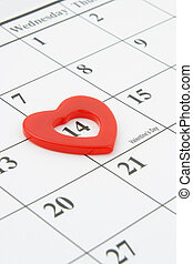 Heart shape marker on calendar page showing February 14 Valentine's Day