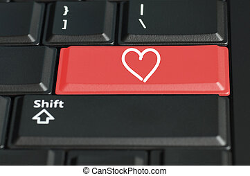Heart shape on a keyboard - Concept of love call to action....