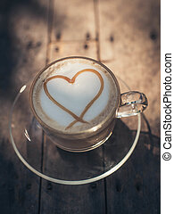 Heart shape on creamy coffee with natural light.