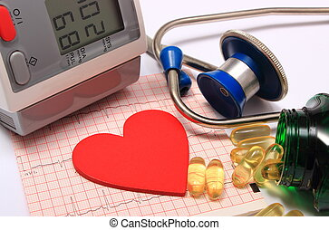 Heart shape on electrocardiogram, blood pressure monitor, stethoscope