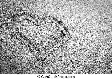 Heart shape on sand. Romantic, black and white