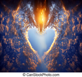 Heart shape on sunset sky