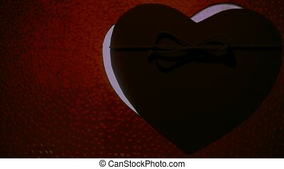 Heart shape present box on bokeh background. St. Valentine day concept