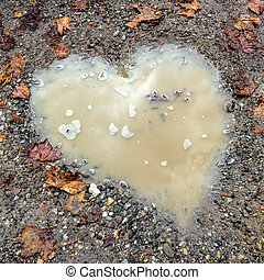 Heart shape puddle - Pothole in the road in the shape of a...