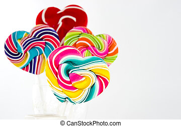 Heart shape Swirl  lollipop on white background