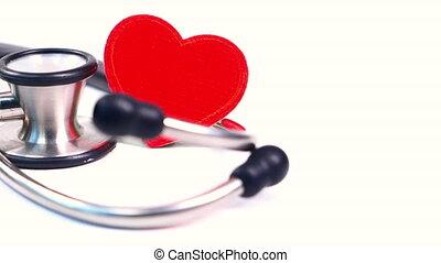 heart shape symbol and stethoscope on white background.